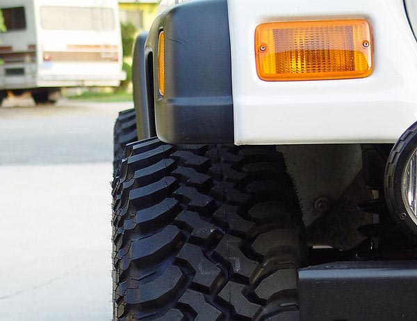 Here You Can See Just How Much (or How Little) A 32x11.50 Tire Sticks Out  Past Jeep TJ Sport Flares.